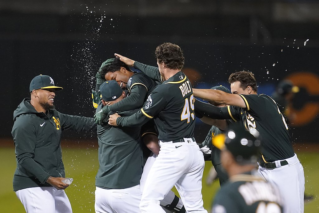A's get a boost from bottom half of lineup
