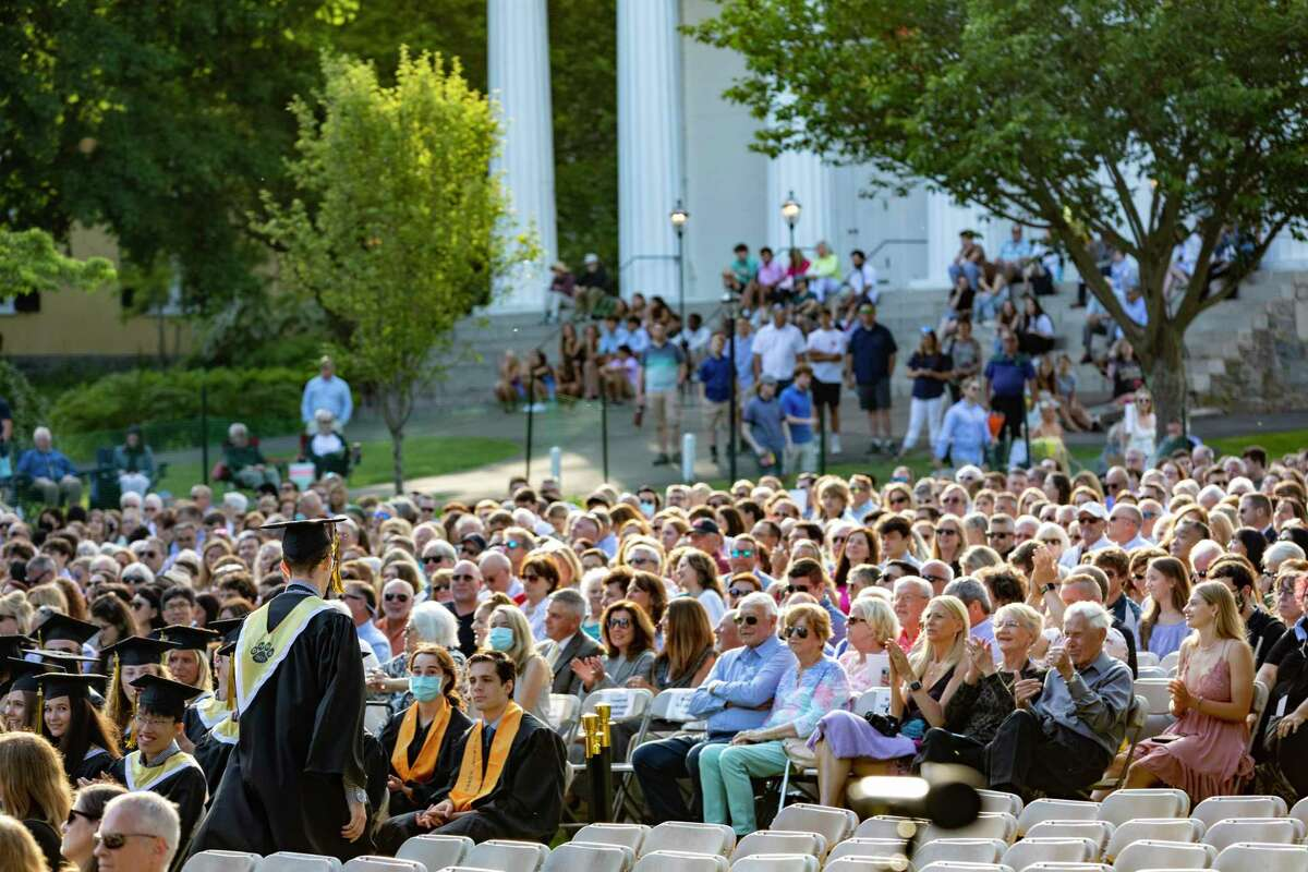 The graduating class of Daniel Hand High School gathered for commencement in person on Friday, June 11, 2021 in front of the Congregational Church in Madison. The in-person commencement ceremony marked a departure from the year before when most graduation ceremonies were held virtually due to the pandemic.