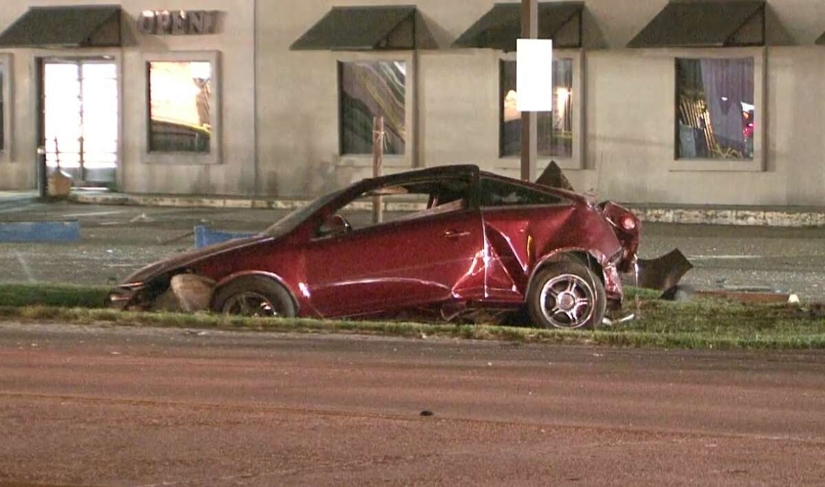 A woman died early Saturday after slamming into a road sign and being ejected from her car in north Harris County.