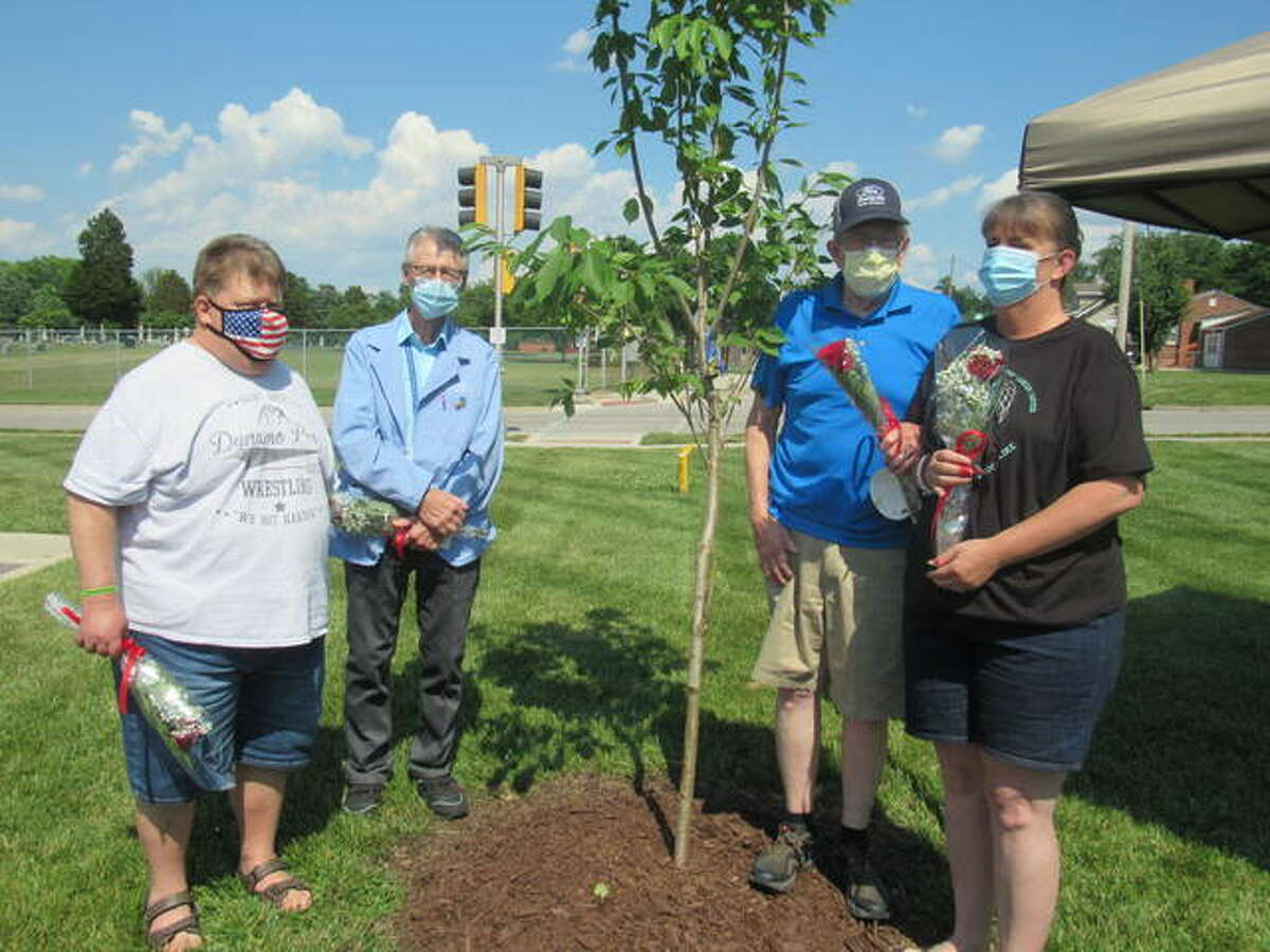 To mark Cancer Survivor Day, the OSF Moeller Cancer Center in Alton has planted a Kwanzan Cherry Tree that will be decorated with bells, each belonging to present and future survivors of cancer. Pictured from left are Larry Nickel, Bud Webb, Larry Sams and Suzie Bangert.