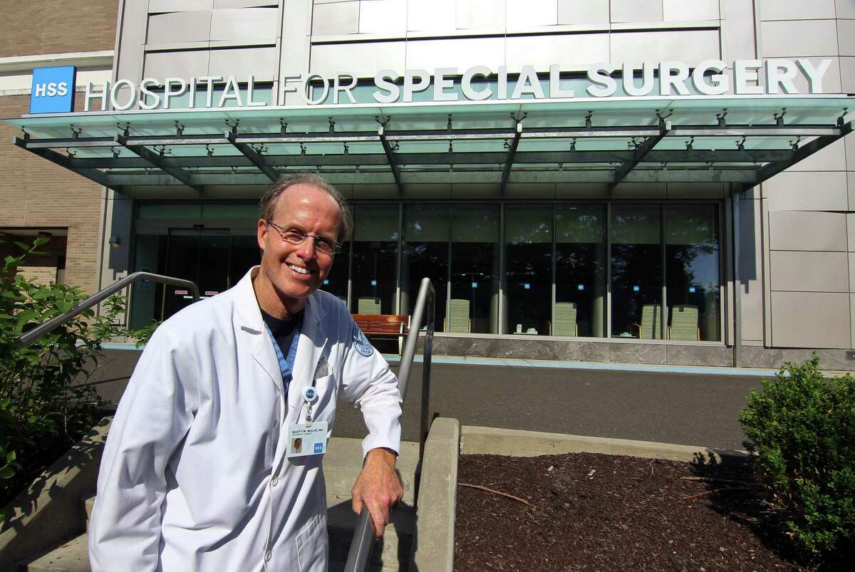 Dr. Scott Wolfe, who performed a total wrist replacement, the first of its kind in the world, poses at the Hospital for Special Surgery in Stamford, Conn., on Thursday June 10, 2021.