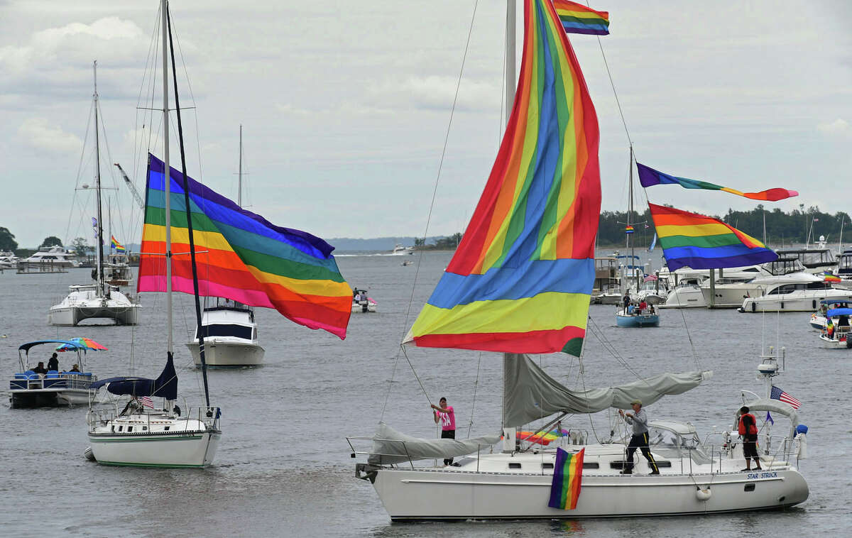 Participants in the Pride Parade of Sail motor through Norwalk Harbor Saturday, June 12, 2021, in Norwalk, Conn. Vessels made rendezvous between Peach Island and Norwalk Cove Marina, sailed to the Maritime Center and Calf Pasture Beach, and then out to Sheffield Island for a celebration and Lobster Bake. All proceeds from the event benefit the Triangle Community Center.