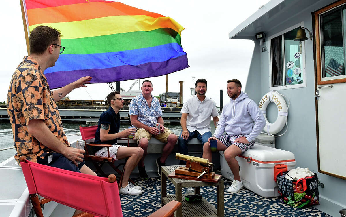 Participants in the Pride Parade of Sail including Quintin Settle, Sean Diaz, Jeff Powers, Scott Gretz and Stephen Lucin, prepare to motor through Norwalk Harbor Saturday, June 12, 2021, in Norwalk, Conn. Vessels made rendezvous between Peach Island and Norwalk Cove Marina, sailed to the Maritime Center and Calf Pasture Beach, and then out to Sheffield Island for a celebration and Lobster Bake. All proceeds from the event benefit the Triangle Community Center.