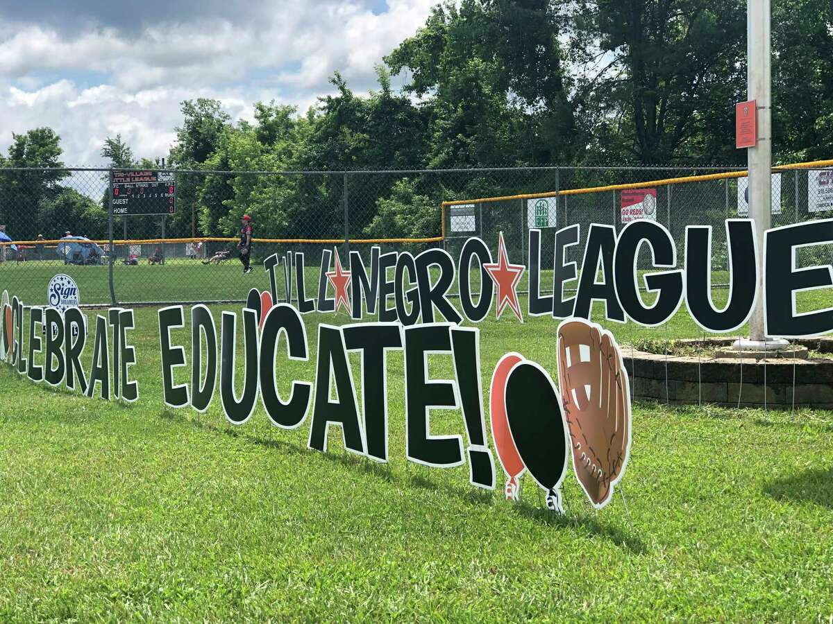 """Tri-Village Little League held a """"Negro Leagues 101"""" celebration at Magee Park on Kenwood Avenue in Delmar on Saturday, June 12, 2021. Sign Dreamers of the Capital District donated this sign to the league for the event."""