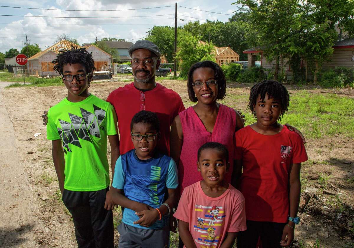 Marvin McNeese Jr., his wife, Melanie, and their children visit the site of a future pocket park Thursday that he has fought for over the last five years.
