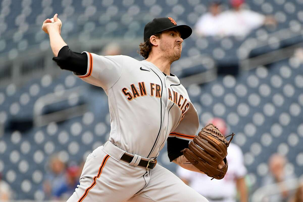 WASHINGTON, DC - JUNE 12: Kevin Gausman #34 of the San Francisco Giants pitches against the Washington Nationals during the first inning of game one of a doubleheader at Nationals Park on June 12, 2021 in Washington, DC. (Photo by Will Newton/Getty Images)