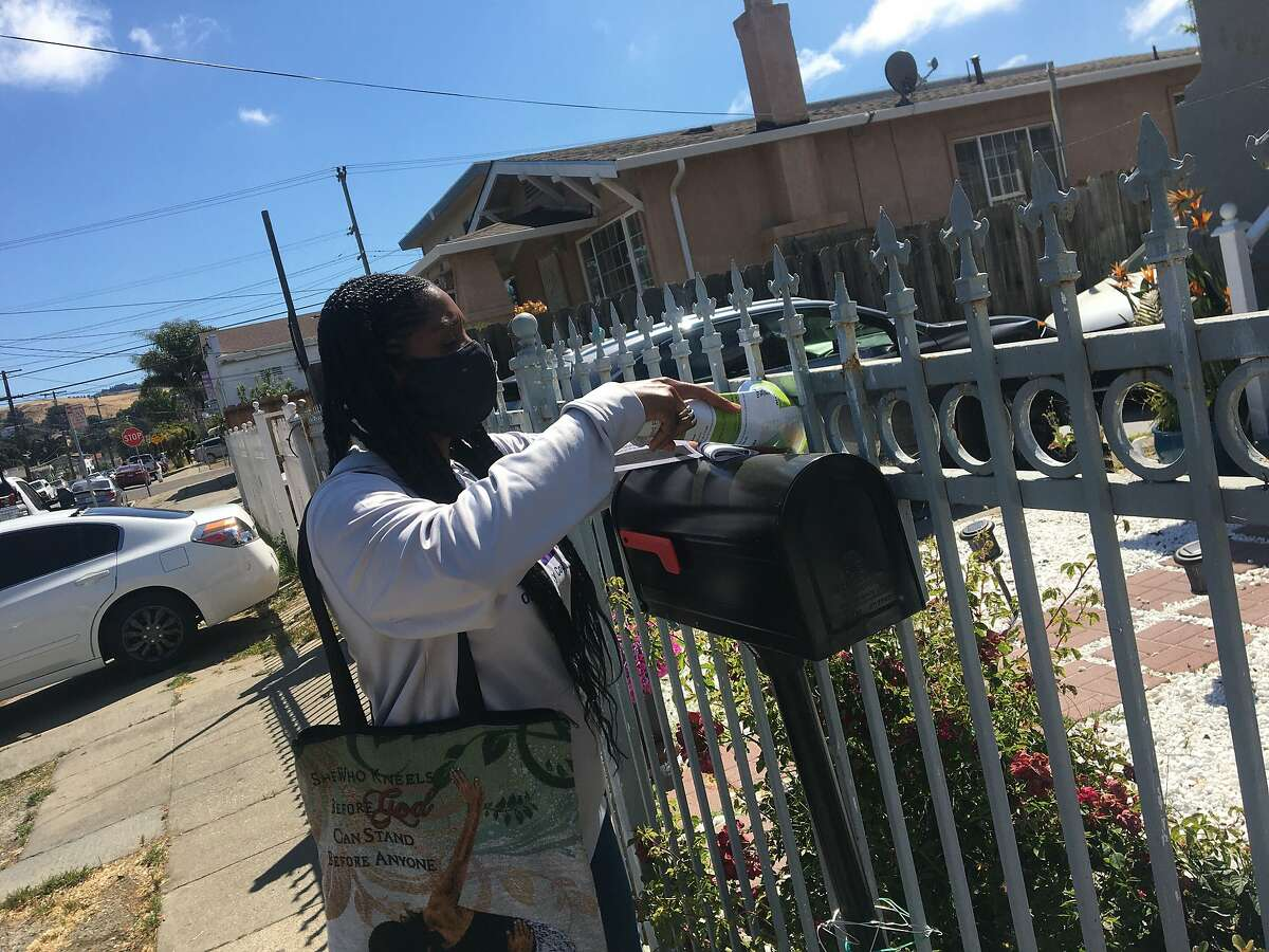 Oakland City Council Member Treva Reid distributes flyers in East Oakland to encourage eligible residents to sign up for a guaranteed income pilot program for 1½ years.