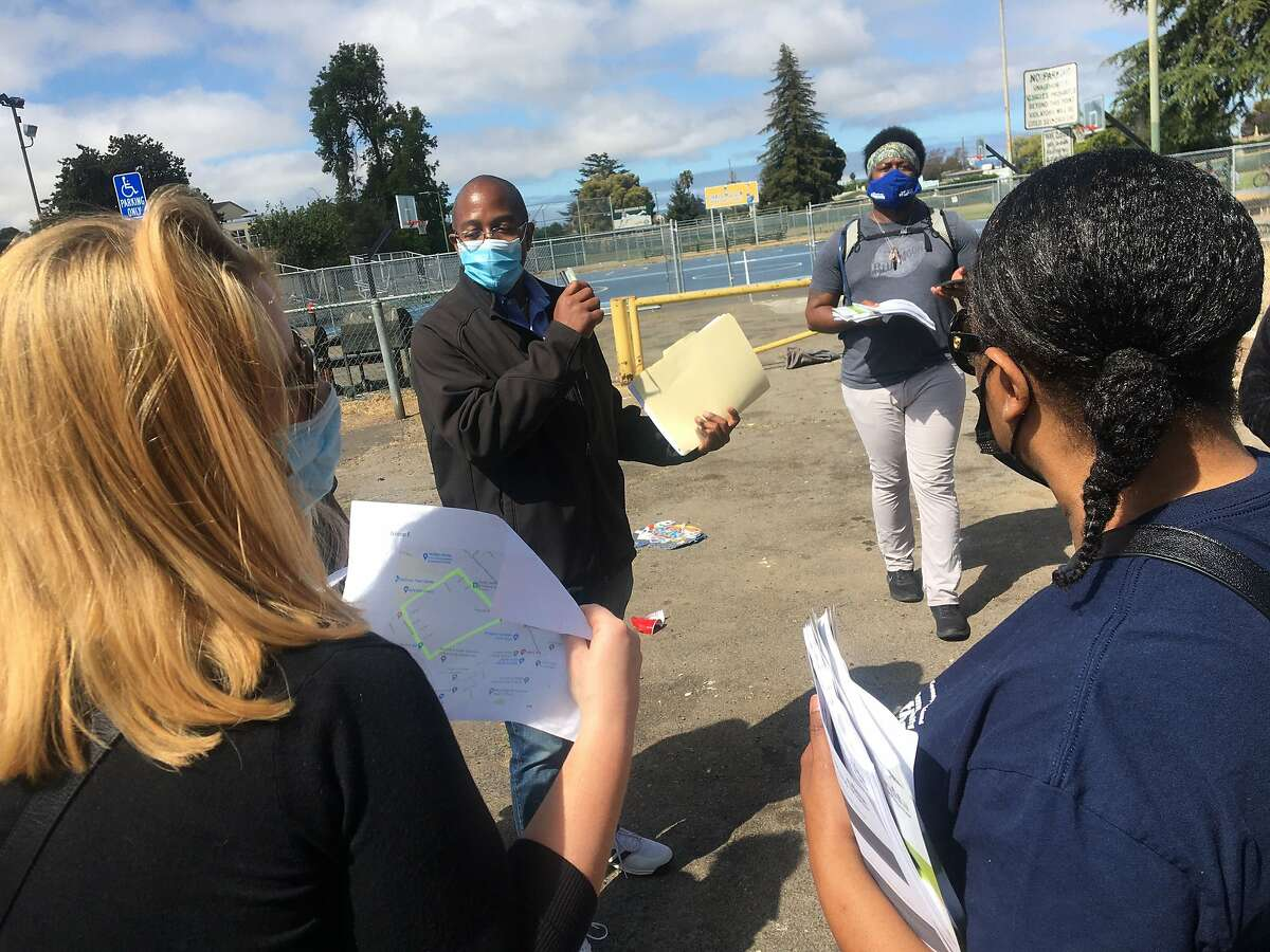 Oakland City Council Member Loren Taylor addresses canvassers who set out Saturday morning in East Oakland to promote a guaranteed income pilot program that will distribute $2.7 million to 300 qualified residents over an 18-month period.