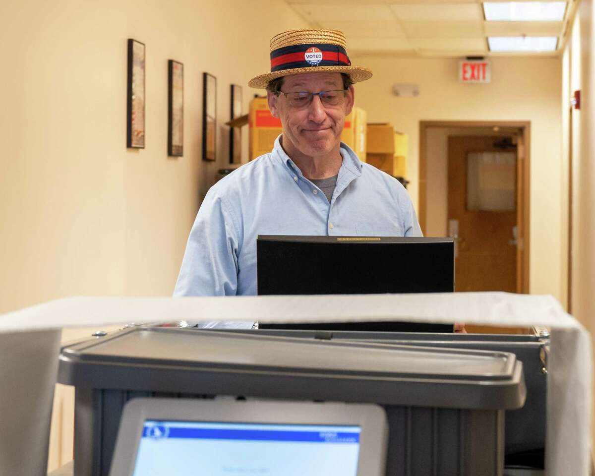 Voter Russ Myer casts a ballot at the Albany County Board of Elections on the first day of early voting, Saturday, June 12, 2021. The BOE is an early voting polling place for the primary that culminates on June 22 (Jim Franco/Special to the Times Union)