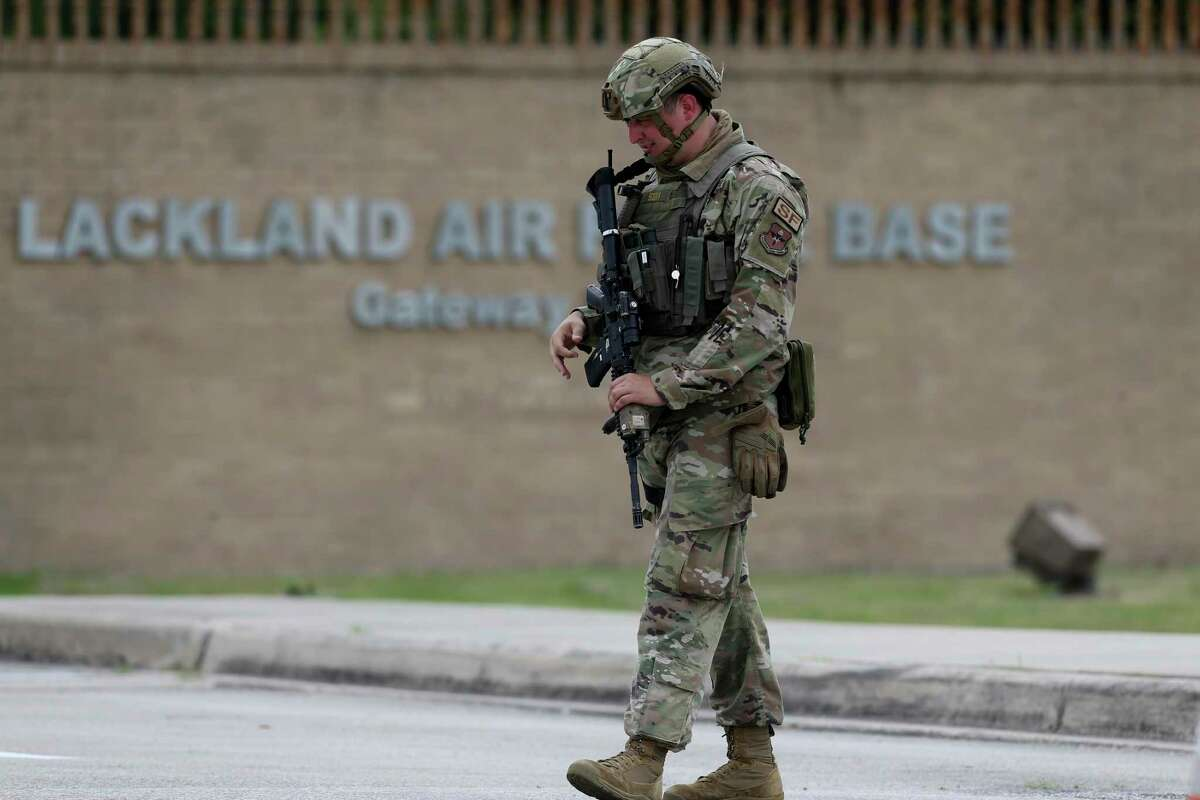 """Soldiers guard the Gateway West Gate as Joint Base San Antonio-Lackland goes into full lockdown after reports of gunfire Wednesday. The San Antonio Police Department said Saturday the reports were not """"credible."""""""