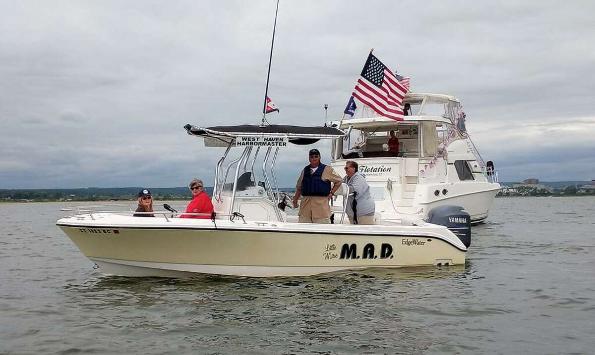 West Haven Mayor Nancy Rossi, Personnel and Labor Relations Director Beth Sabo, West Haven Harbor Master Robert Pimer, and his wife Maria, during the West Haven Centennial Boat Parade Saturday June 12, 2021 on Long Island Sound.