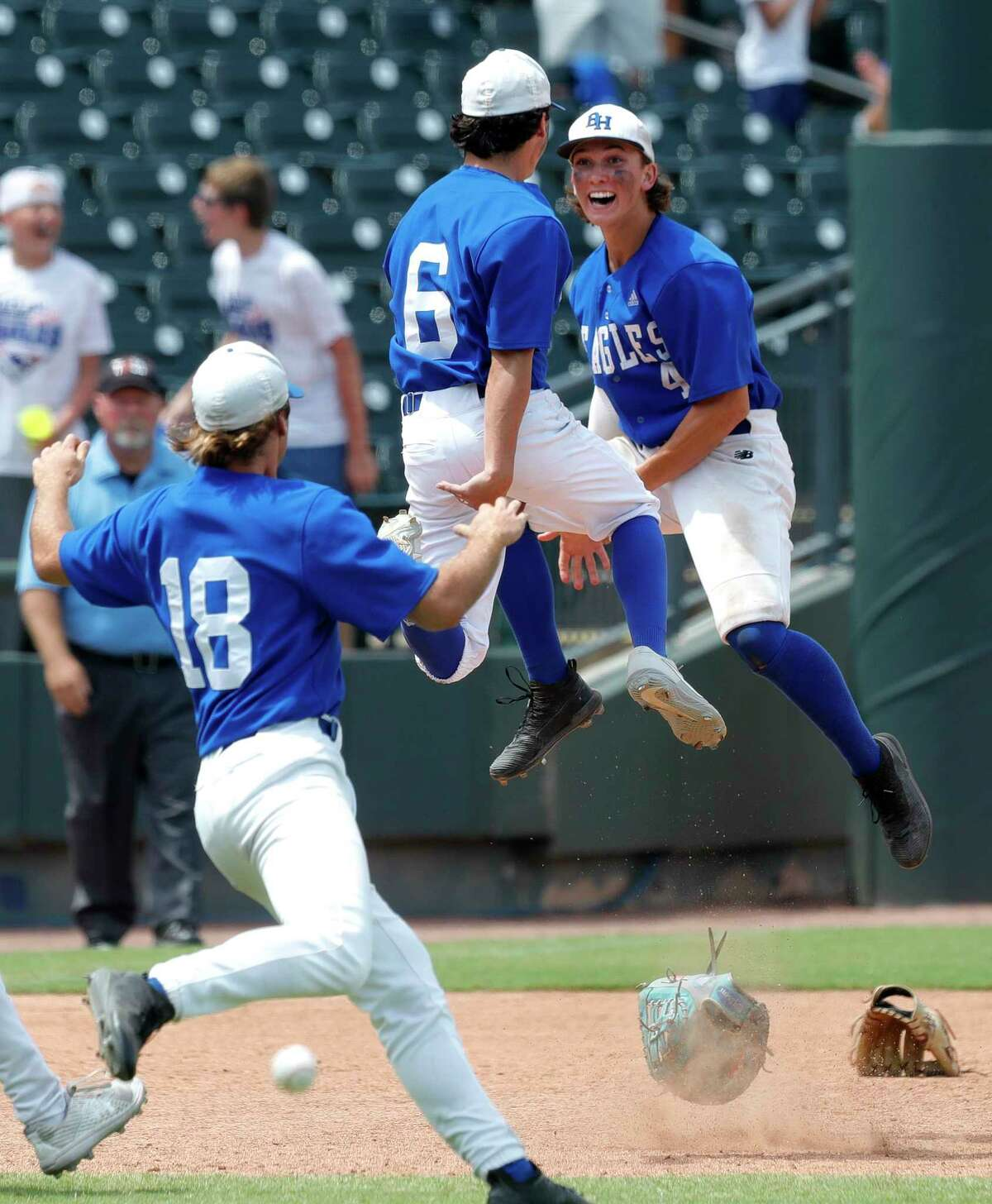 Barbers Hill shortstop Cameron Cauley (4) and relief pitcher Raithen Malone (6) celebrate after defeating Hallsville 2-1 to win the Class 5A state championships at Dell Diamond, Saturday, June 12, 2021, in Round Rock.