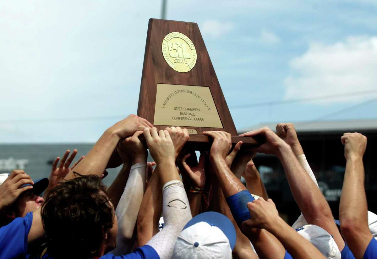 Barbers Hill celebrates after defeating Hallsville 2-1 to win the Class 5A state championships at Dell Diamond, Saturday, June 12, 2021, in Round Rock.