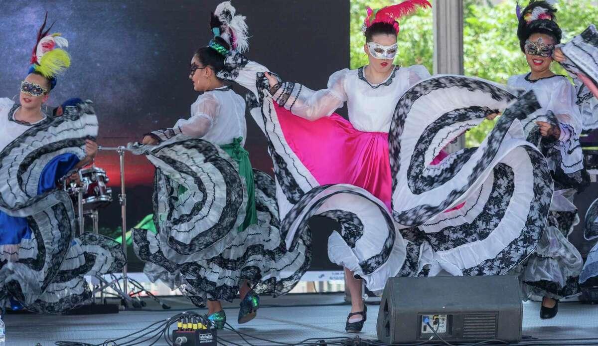 Folklorico dancers perform at Centennial Plaza during Mex-Tex Fiesta 06/12/2021 in downtown Midland. Tim Fischer/Reporter-Telegram
