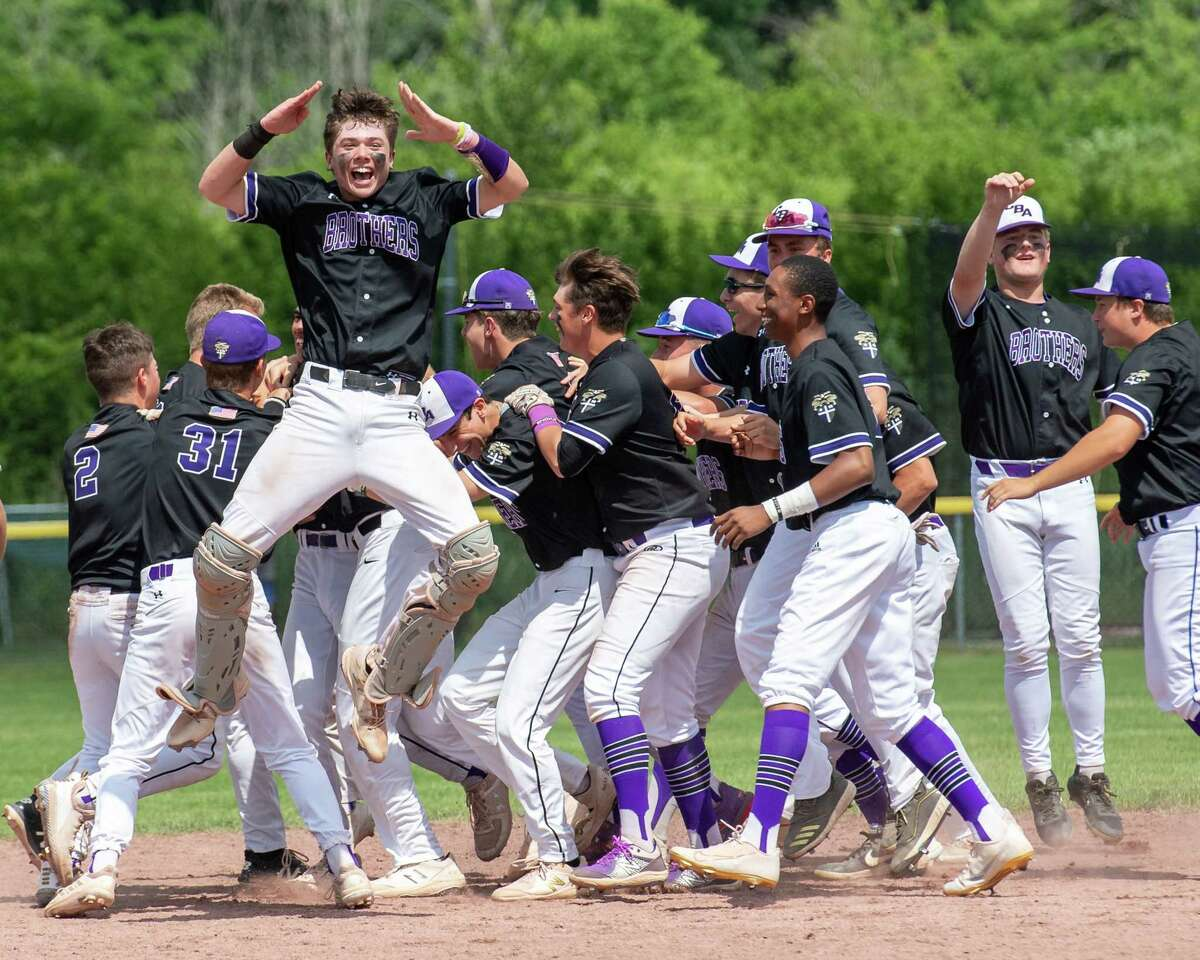 CBA celebrates after beating Colonie in the Class AA semifinals at CBA in Colonie, NY, on Saturday, June 12, 2021. CBA will take on Shaker in the finals (Jim Franco/Special to the Times Union)