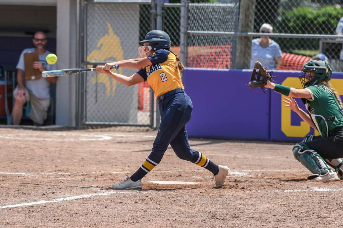 Midland high's Kiara Kiely connects with a ptich during the regional semi final game at McGregor Elementary in Bay City, MI on June 12, 2021 (Adam Ferman/for the Daily News)
