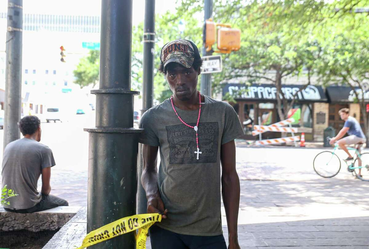 Unique White is pictured at the intersection of Sixth Street and Trinity, where he was standing in the early morning hours of June 12, 2021. One of the 14 people shot died of his injuries on Sunday.