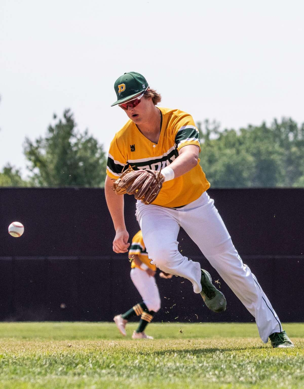 Dow's Jack Bakus scrambles for the ball during the Chargers'9-6 win over Zeeland West in Saturday's Division 1 regional final at Central Michigan University.