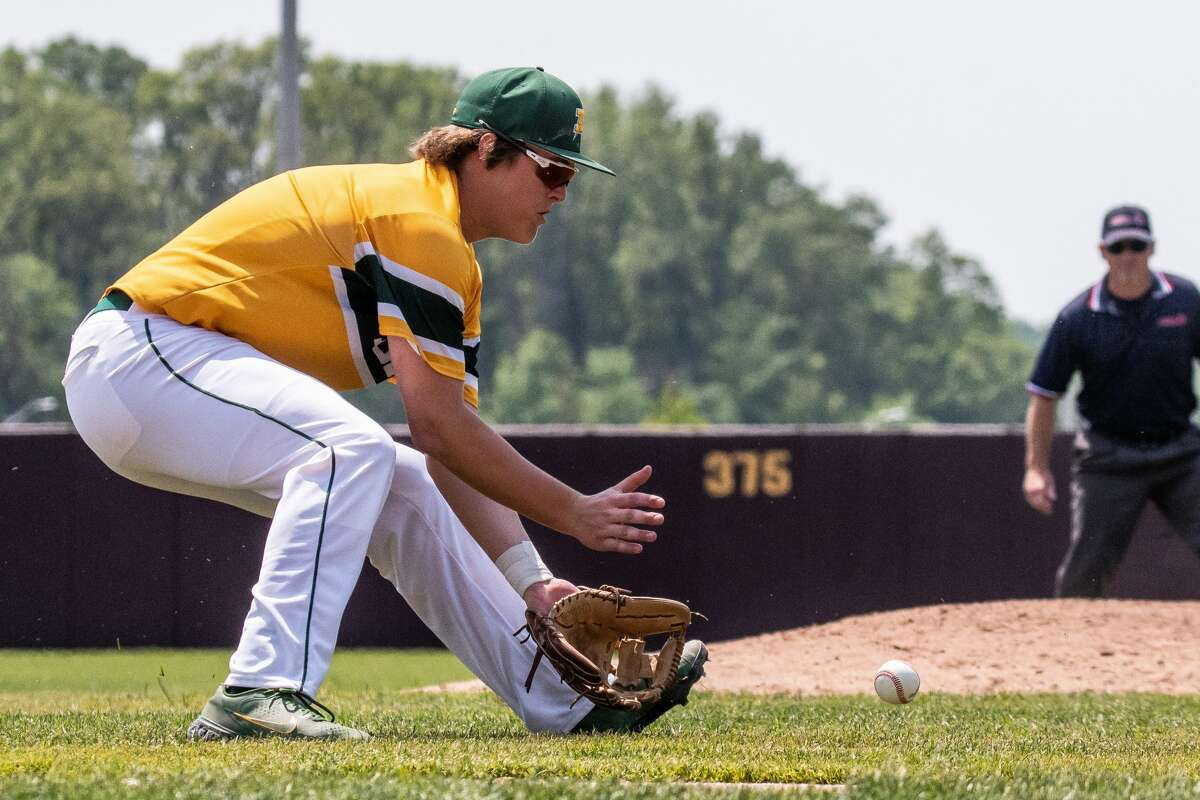 Dow's Jack Bakus fields a grounder during the Chargers' 9-6 win over Zeeland West in Saturday's Division 1 regional final at Central Michigan University.