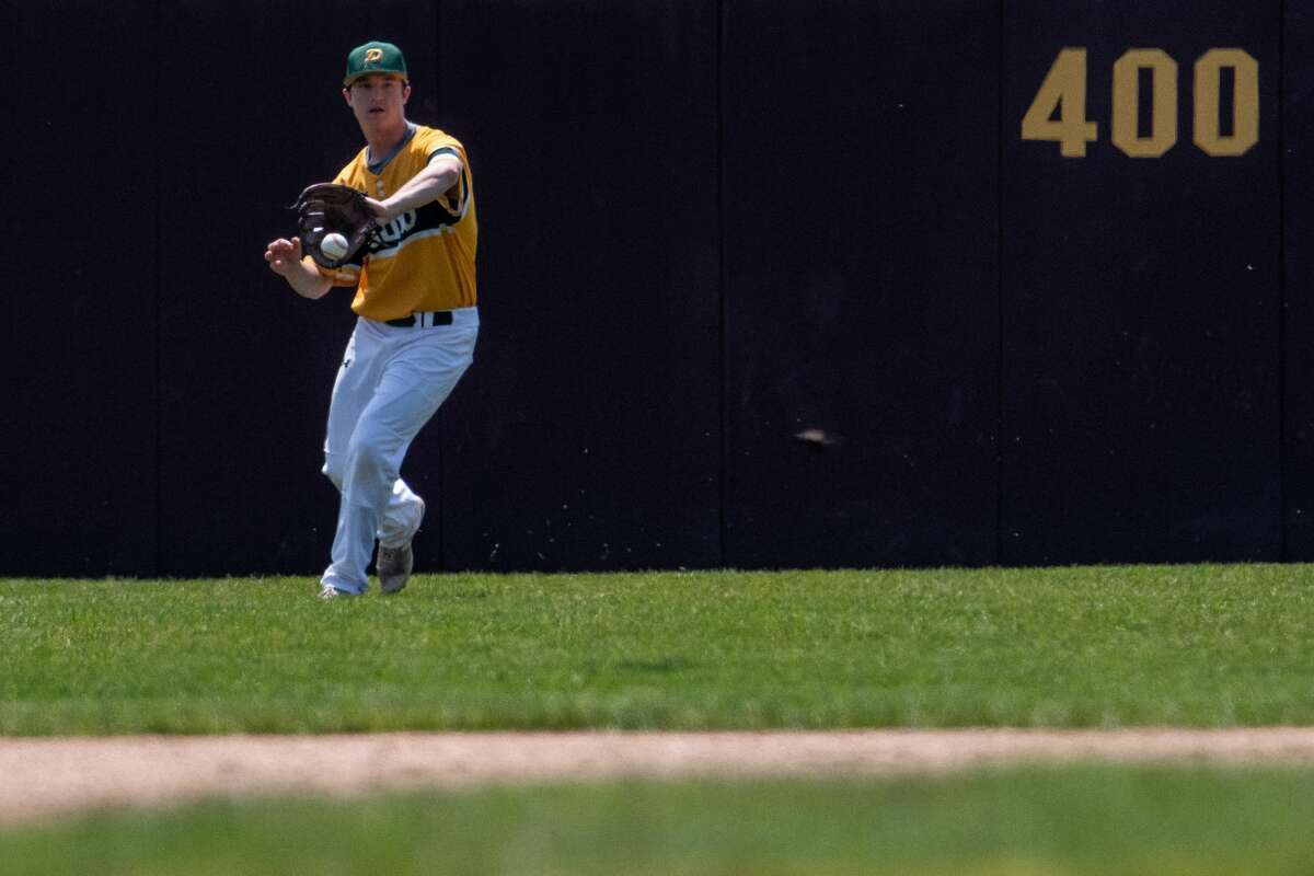 Dow's Riley Nelson fields the ball during the Chargers' 9-6 win over Zeeland West in Saturday's Division 1 regional final at Central Michigan University.