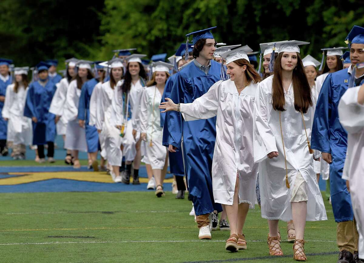 Newtown High School holds commencement exercises Saturday, June 12, 2021, on the school's football field.