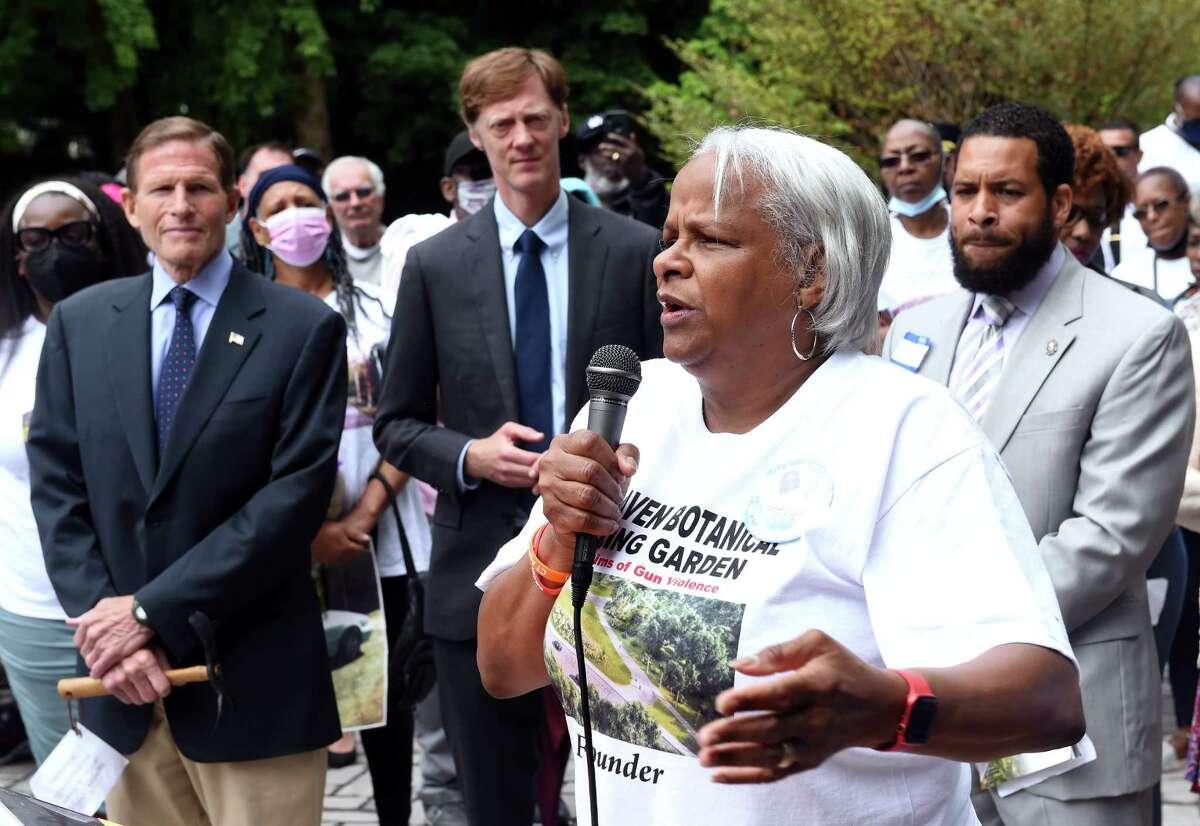 Marlene Miller Pratt (right), a founding member of the Botanical Garden Nucleus Group, speaks at the dedication of the New Haven Botanical Garden of Healing on June 12, 2021.