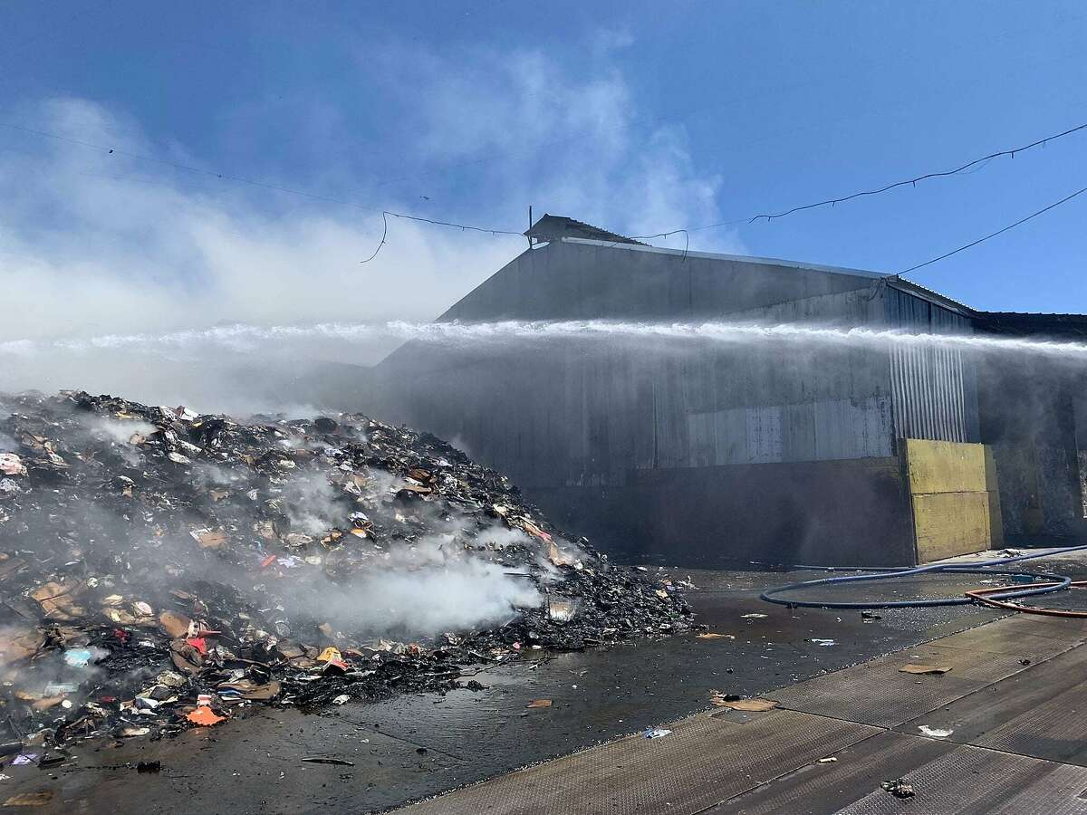 The scene of a three-alarm fire at a West Oakland waste facility on June 12, 2021