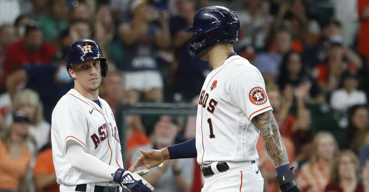 Houston Astros Carlos Correa (1) celebrates his run scored with Myles Straw (3) after Taylor Jones'sacrifice fly during the second inning of an MLB baseball game at Minute Maid Park, Monday, May 31, 2021, in Houston.