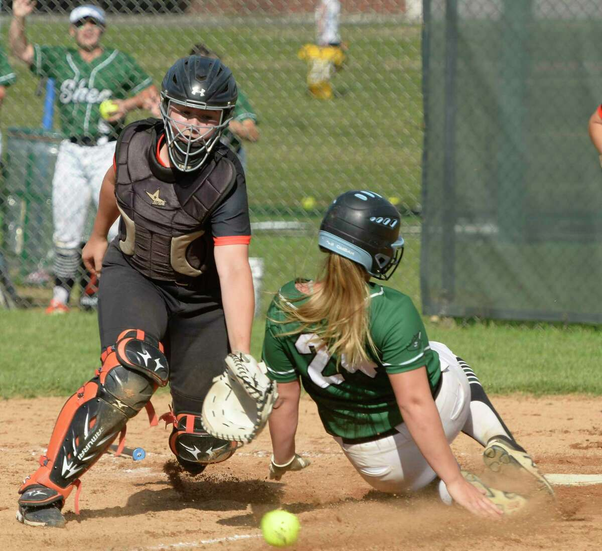 Shen's Hannah Smith slides home before Bethlehem catcher Ella Traynor catches the ball during the Class AA sectional final on Saturday, Jun. 12, 2021, in Clifton Park, N.Y. (Jenn March, Special to the Times Union)