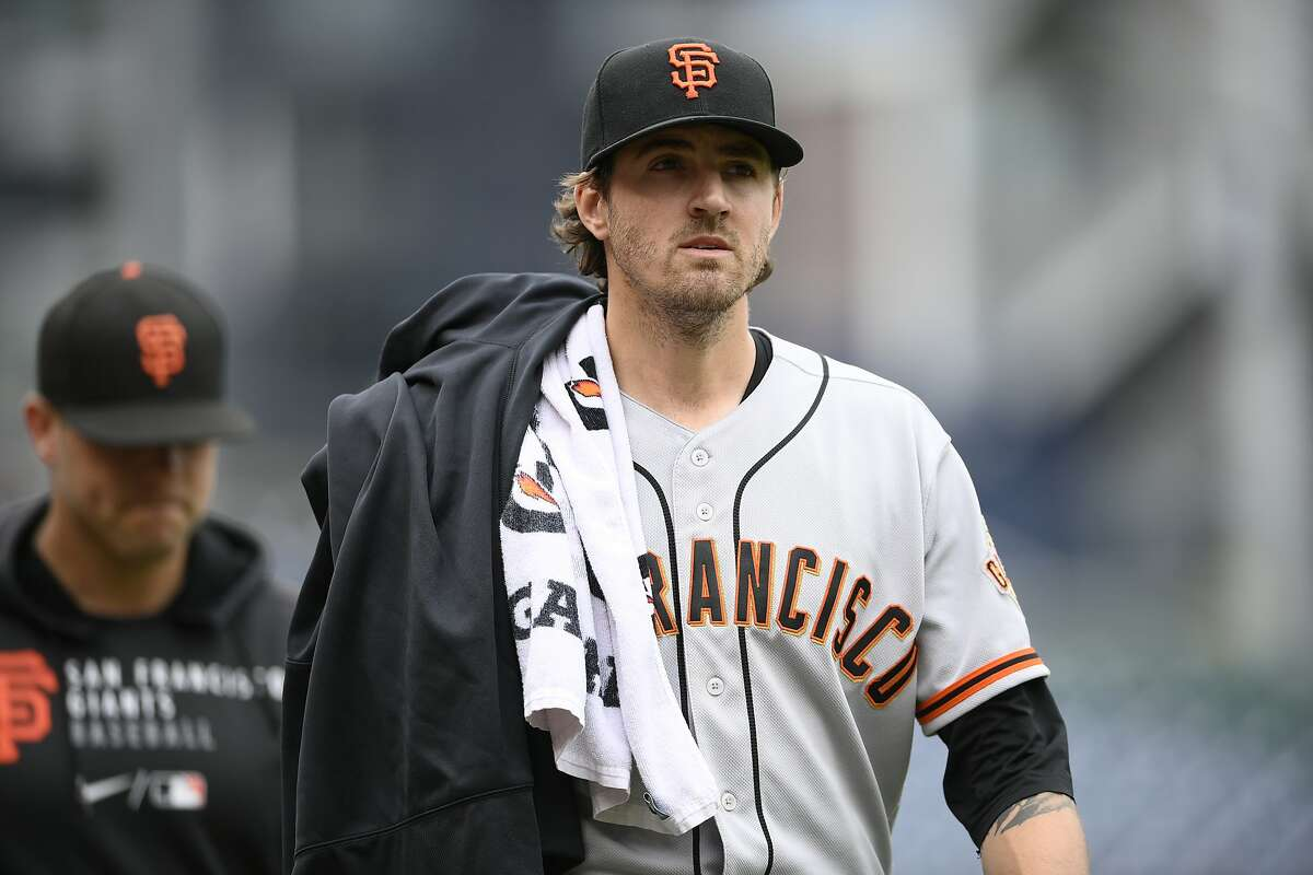 San Francisco Giants starting pitcher Kevin Gausman (34) walks to the dugout before the first baseball game of a doubleheader against the Washington Nationals, Saturday, June 12, 2021, in Washington. This game is a makeup of a postponed game from Thursday. (AP Photo/Nick Wass)