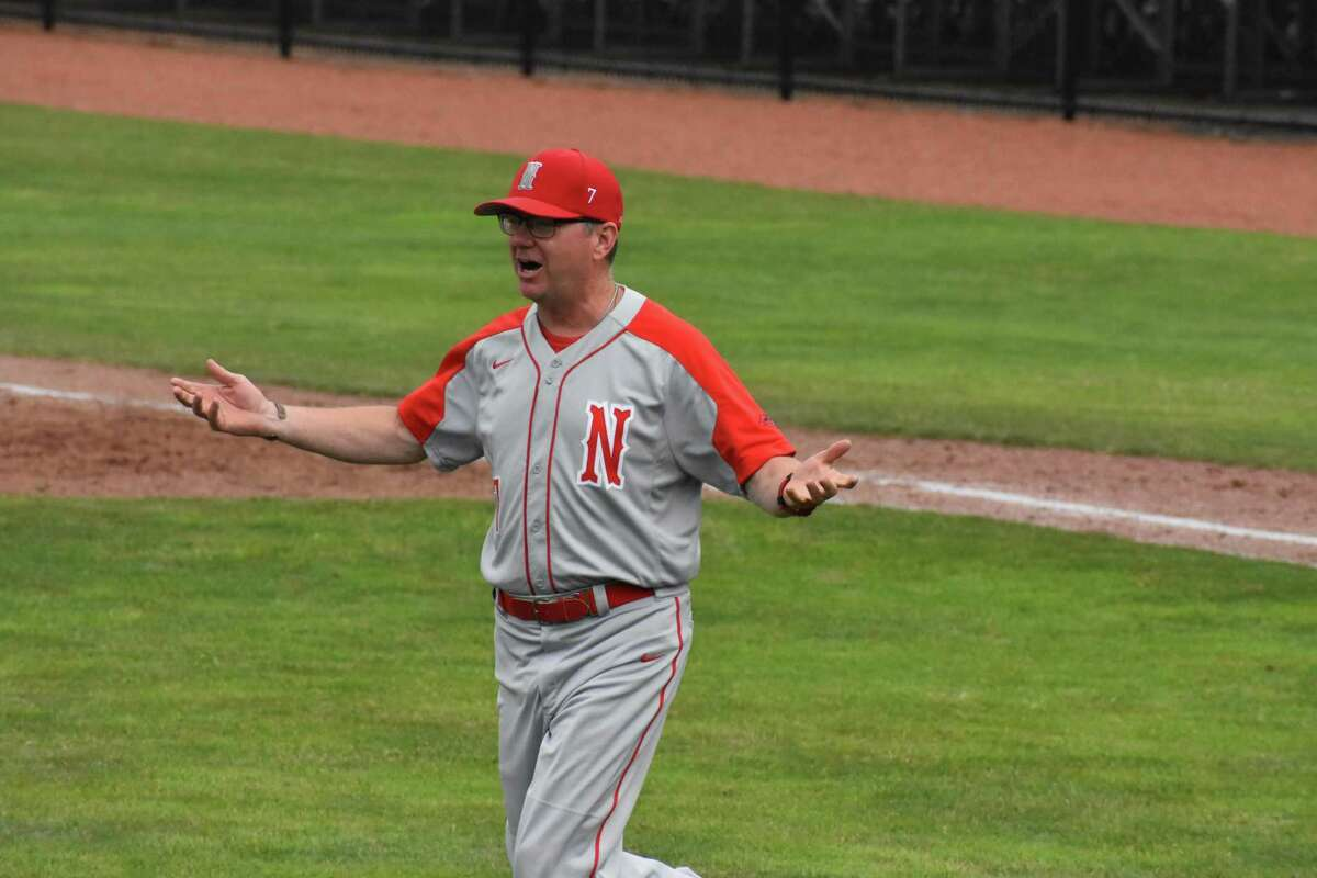 Northwestern coach Kevin Nelligan contests a call with an umpire during the Class M championship at Palmer Field in Middletown on Saturday.