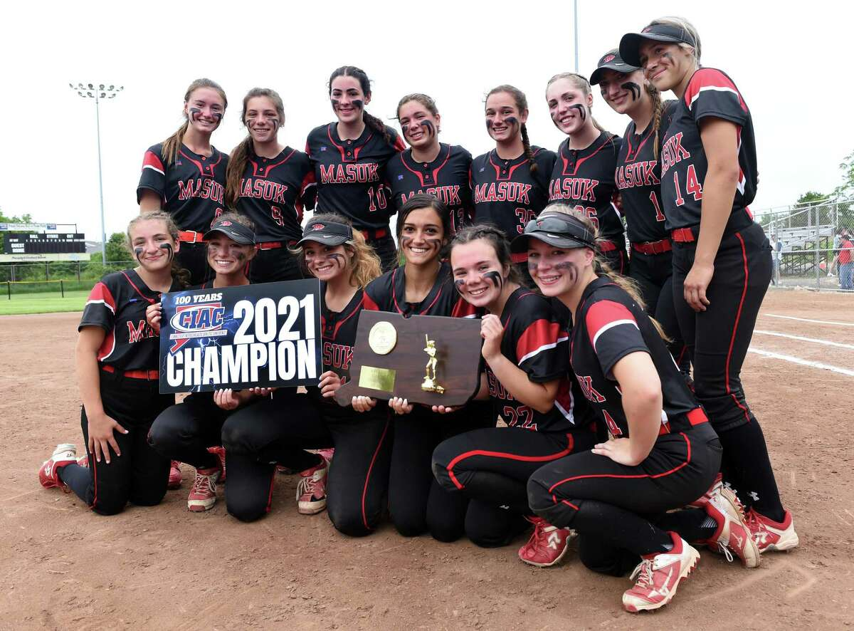 Masuk celebrates after defeating St. Joseph 2-0 in the Class L Softball Championship in Stratford on June 12, 2021.