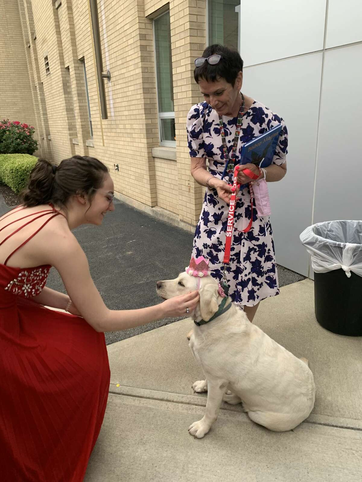 Katie Lewis, valedictorian of the Bishop Maginn High School Class of 2021, crowned the school's therapy dog prom queen on Friday, June 11, 2021.