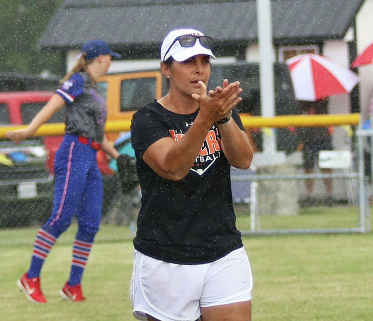 Gillespie coach Michelle Smith encourages a Miners hitters after a foul ball during a first-inning rain in a Class 2A sectional game Tuesday in Gillespie. Smith ended her 15th season as Gillespie coach just two wins away from 300.
