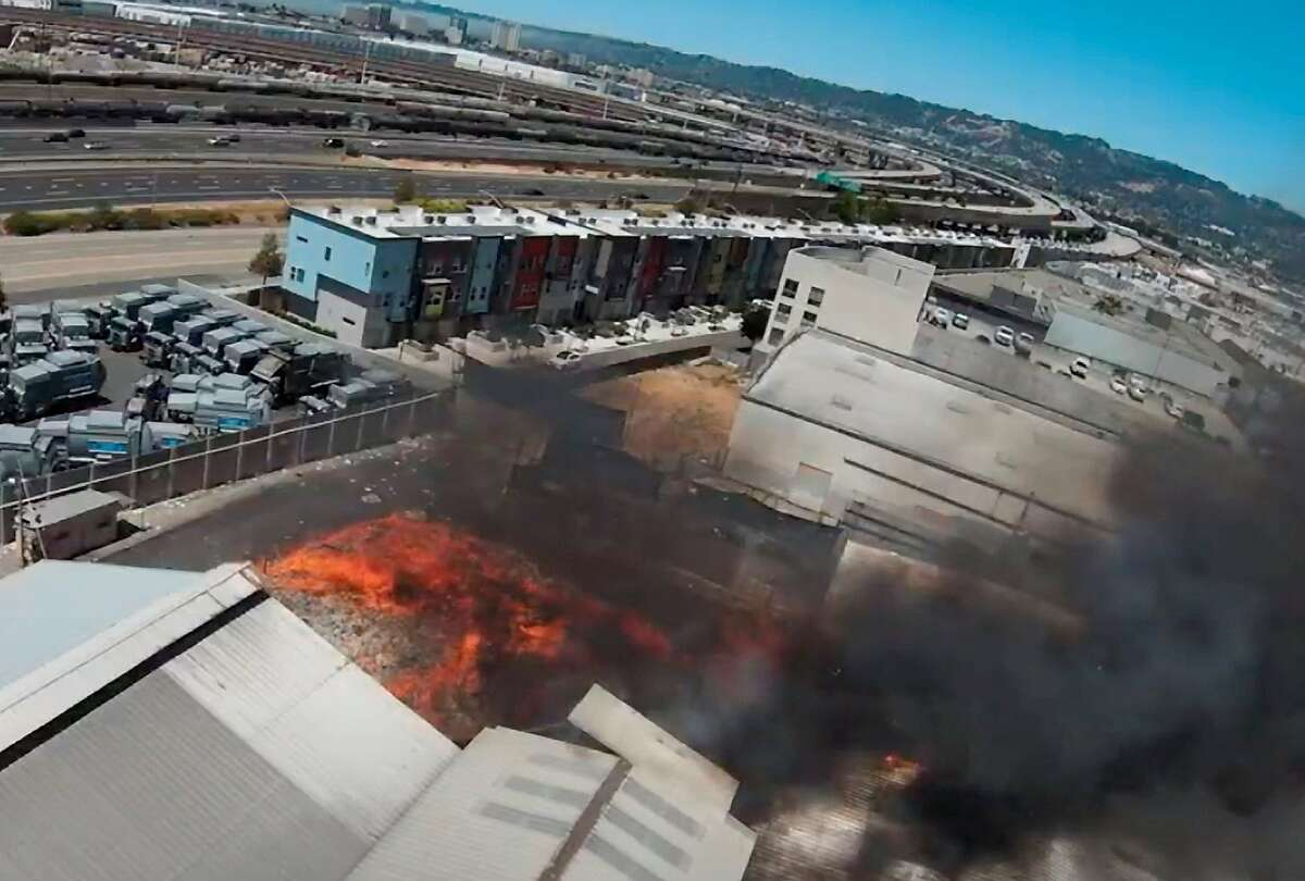 An aerial view of the fire at California Waste Solutions in West Oakland on June 12, 2021. Interstate 880 is behind the facility