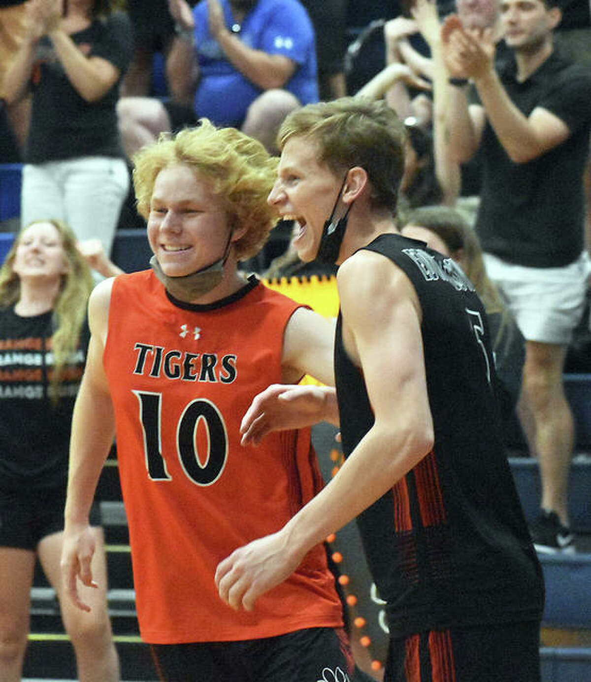 Edwardsville's Tyler Chrenka, left, and Preston Weaver celebrate after beating O'Fallon in the Minooka Sectional semifinals on Saturday in Belleville.