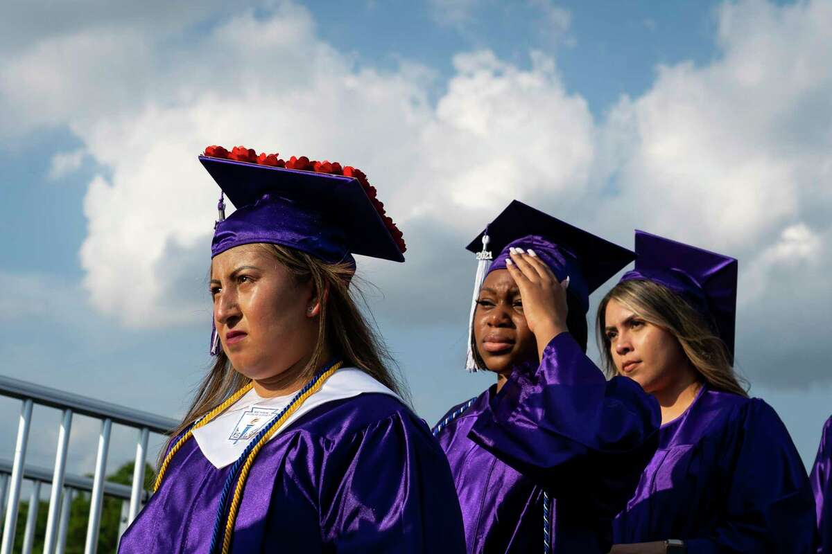 Lizbeth Contreras Tovar waits in line just off of the stage as she prepares to walk across and receive her diploma during the commencement ceremony for Wheatley High School on Saturday, June 12, 2021, at Barnett Stadium in Houston.
