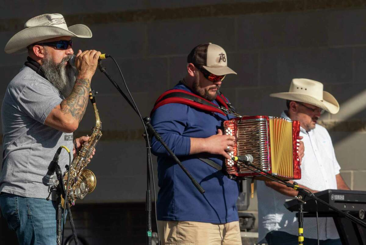 Members of Art Tigerina Band perform in Centennial Plaza during Mex-Tex Fiesta 06/12/2021 in downtown Midland. Tim Fischer/Reporter-Telegram