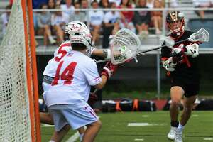 Ridgefield's Luke Winkler (4) scores the go ahaed goal in the fourth period as the Fairfield Prep High School Stags take on the Ridgefield High School Tigers in their CIAC boys lacrosse class L championship game Saturday, June 12, 2021, at Trumbull High School in Trumbull, Conn.