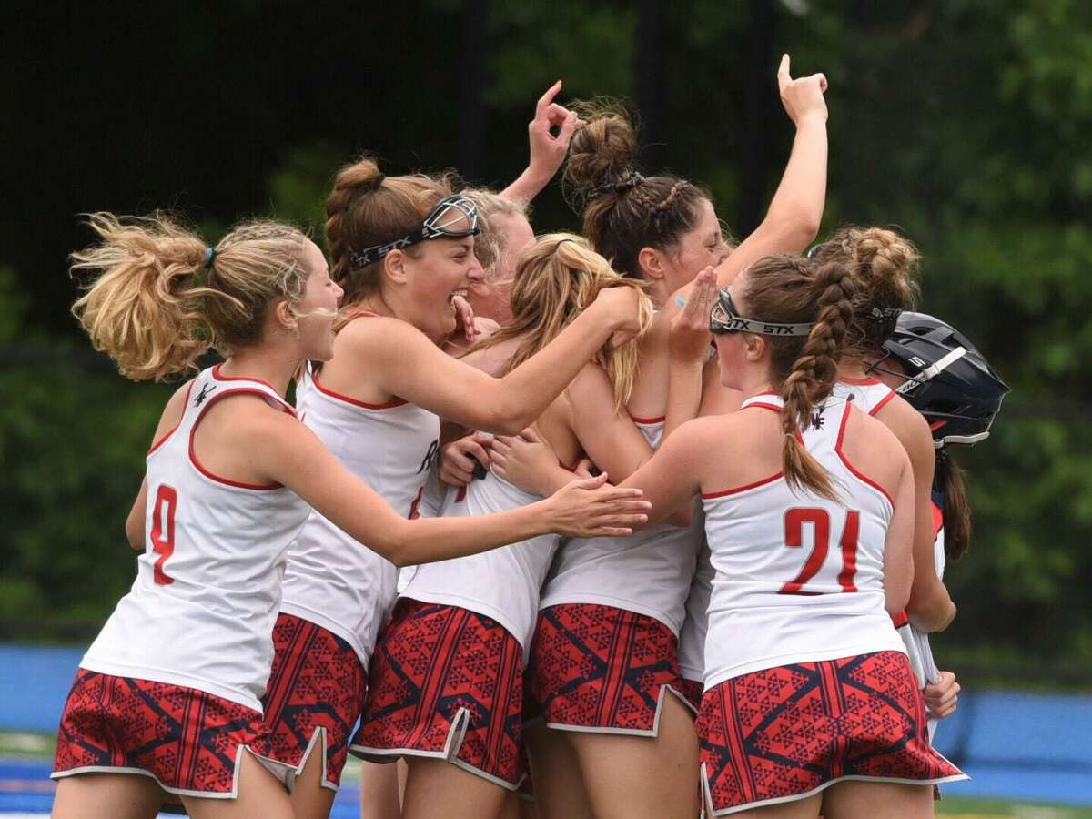 New Fairfield celebrates its 11-8 win over Weston in the CIAC Class S girls lacrosse championship on Saturday, June 12, 2021 at Bunnell High School in Stratford, Conn.