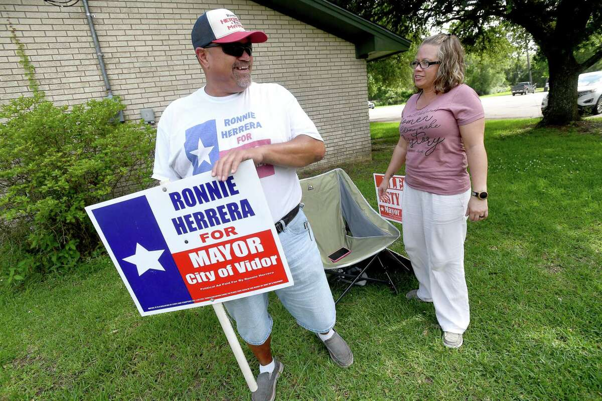 Misty Songe and Ronnie Herrera talk as they campaign on the final day of early voting. The two are vying for the votes to become Vidor's next mayor following Saturday's run-off election. Photo made Tuesday, June 8, 2021 Kim Brent/The Enterprise