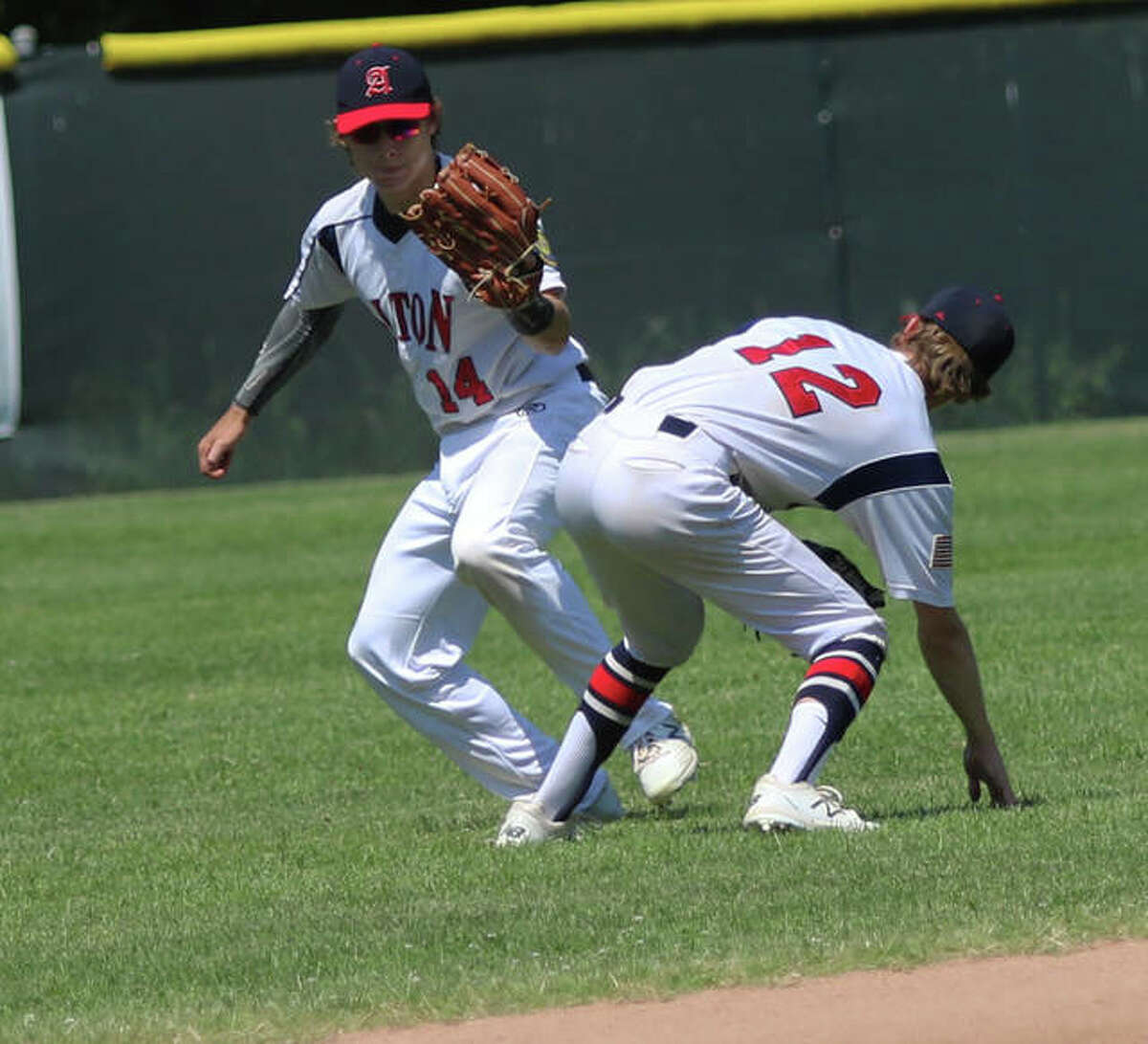 Alton's Preston Schepers, left, went 4 for 4 at the plate with a double, two RBIs and two runs scored in a 10-6 loss to Belleville Saturday in Belleville. He is shown in action last season.