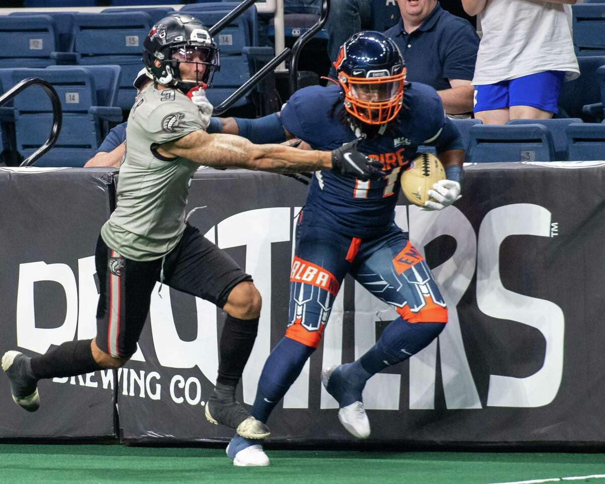 Albany Empire receiver Phillip Barnett heads up the field along the boards in front of Carolina Cobras defender Treavon Homer during their National Arena League game at Times Union Center on June 12, 2021. Barnett is tied for second in the NAL with 31 catches and 10 TD receptions.