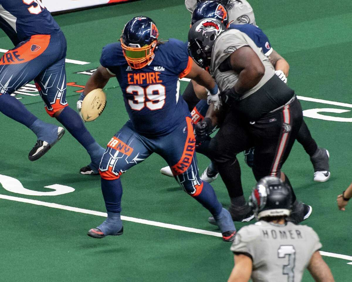 Albany Empire fullback Derrick Ross fights for yardage against the Carolina Cobras during a National Arena League game at the Times Union Center in Albany, NY, on Saturday, June 12, 2021 (Jim Franco/Special to the Times Union)