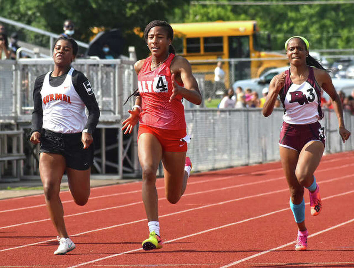 Alton's Renee Raglin (middle) runs the 100 meters at the Class 3A sectional June 2. Raglin, who won the 100 and 200 at the sectional, ran both races at the Class 3A state meet Saturday and finished 19th in the 100 and 12th in the 200.