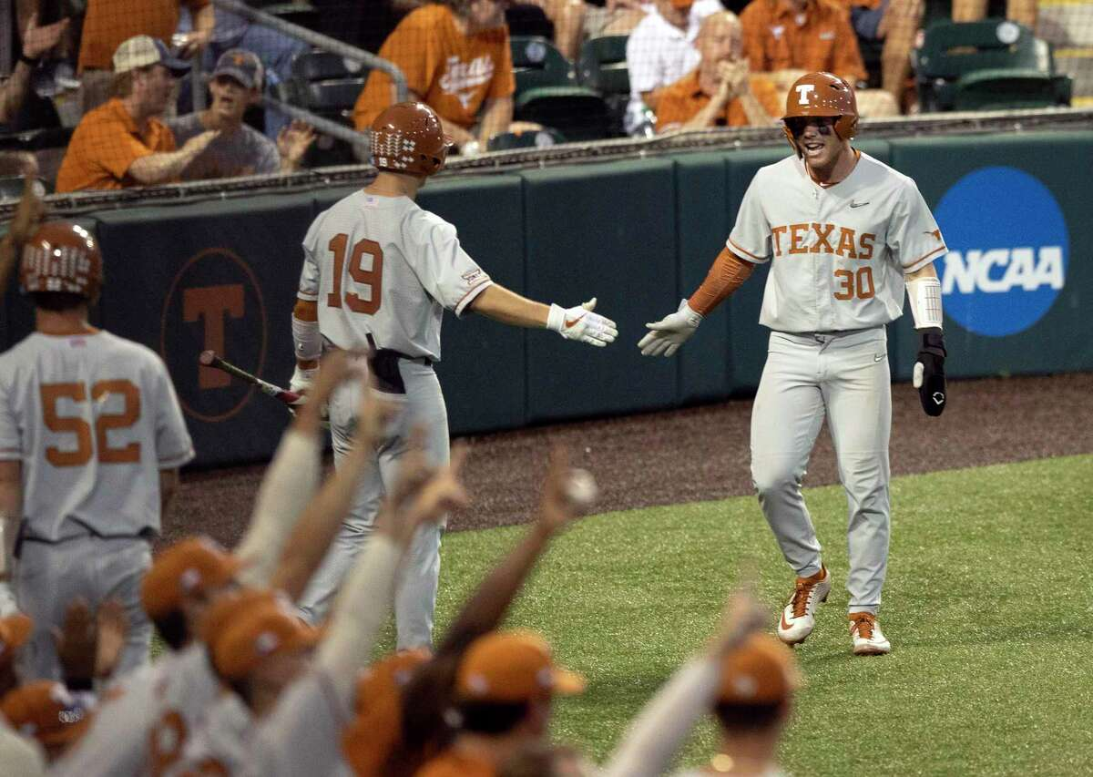 Texas' Eric Kennedy, right, celebrates scoring a run against Fairfield in the second inning of an NCAA college baseball regional tournament at Disch-Falk Field, Sunday on June 6, 2021.