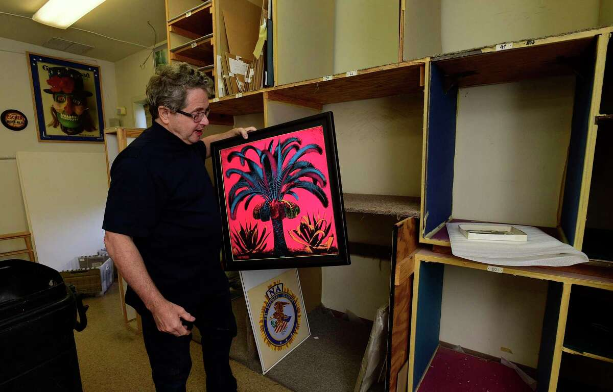 Artist Market owner Jeffery Price packs up the 5,000 square foot studio including some his M. C. Escher collection after nearly 30 years in the same location on Main Street, Thursday, June 10, 2021, in Norwalk, Conn.