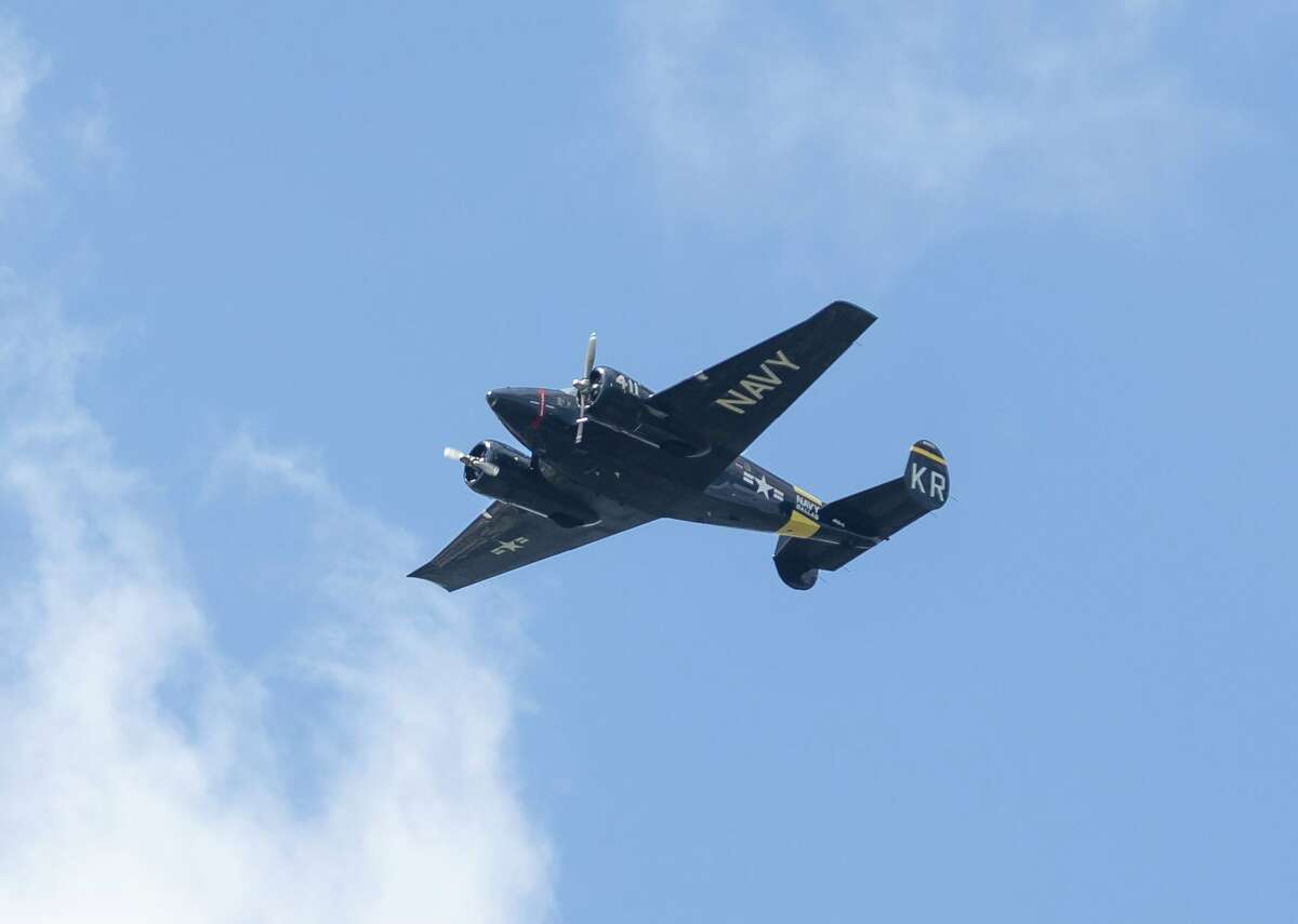 A B-17 aircraft is flown by the Texas Raiders during a flyover at WWII Army Air Corps veteran George Waters' 100th birthday event, Saturday, June 12, 2021, in Conroe. Waters was a B-17 gunner that spent 15 months as a POW.