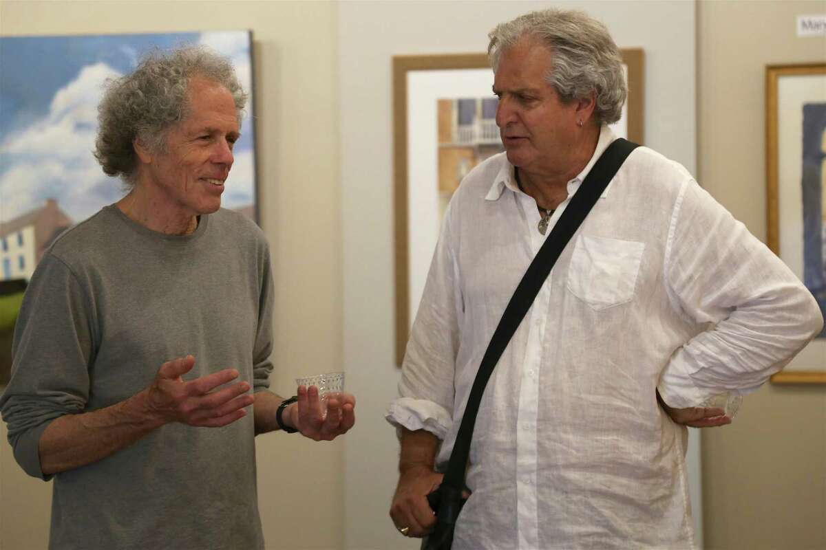 Artist Miggs Burroughs of Westport, left, chats with collector Donald Cohen of Westport at the Artists Collective of Westport's pop-up show at the Westport Country Playhouse's barn on Saturday, June 12, 2021, in Westport, Conn.
