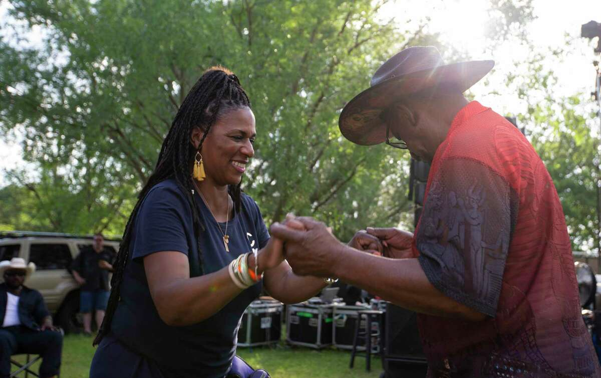 """Donna Whitelow and a man identified as """"Super Dave"""" dance to live music at Camz food truck and entertainment park Saturday, June 12, 2021, at Acres Homes in Houston."""